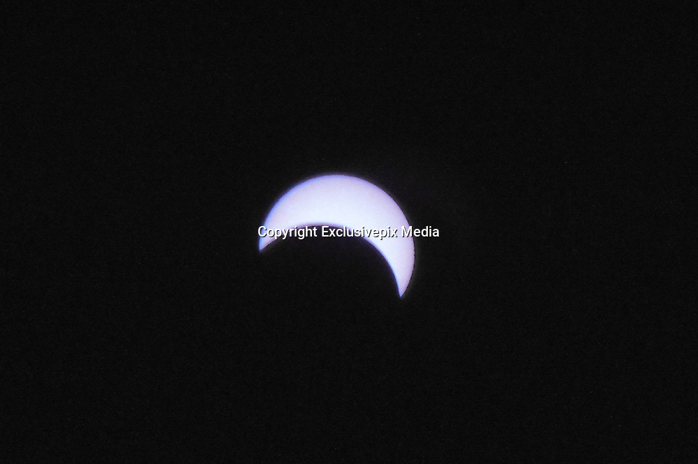March 9, 2016 - Pekalongan, CENTRAL JAVA, INDONESIA - <br /> <br /> A view of the partial solar eclipse captured from Donggala, Palu, Central Sulawesi, Indonesia, on March 9, 2016. The total eclipse of March 9, 2016 starts over the Indian Ocean, made landfall across Indonesia, including Sumatra, Borneo, and Sulawesi, Teluk Tomini and Halmahera in the Moluccas and then headed out over the north Pacific Ocean, to ended near the Hawaiian islands.<br /> ©Exclusivepix Media