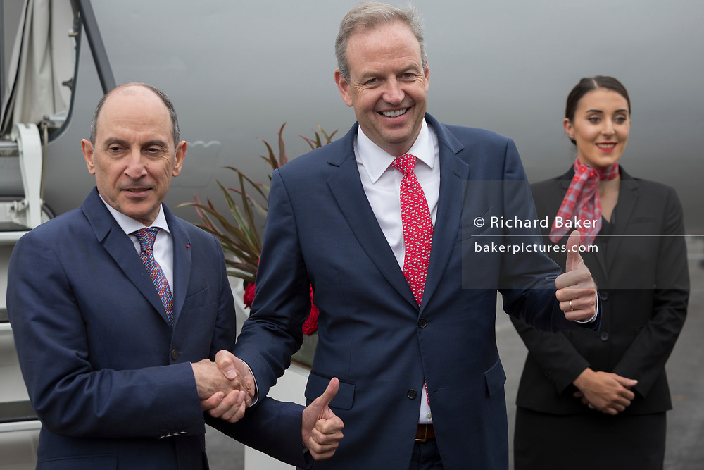 Qatar Airways Group chief executive Akbar al-Baker (left) and JetSuite Inc founder and CEO Alex Wilcox shake hands at the Farnborough Airshow, on 18th July 2018, in Farnborough, England. Their meeting reaffirmed their commitment to expanding JetSuite and JetSuiteX. In April 2018, Qatar Airways took a minority stake in leading US private aviation company JetSuite and its sibling company, JetSuiteX.