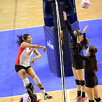 111413  Adron Gardner/Independent<br /> <br /> Shiprock Chieftain Katura Garcia (12) releases a spike to the Raton Tigers during the state volleyball tournament at the Santa Ana Star Center in Rio Rancho Thursday.