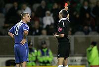 Photo: Marc Atkins.<br /> Milton Keynes Dons v Farsley Celtic. The FA Cup. 21/11/2006. Simeon Sambrooke of Farsley Celtic reacts after being sent off by Referee Mike Thorpe.