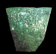 Jade plaque showing a seated king and palace attendant.