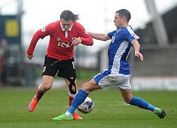 Bristol City's Luke Freeman is tackled by Oldham Athletic's Mike Jones - Photo mandatory by-line: Dougie Allward/JMP - Mobile: 07966 386802 - 03/04/2015 - SPORT - Football - Oldham - Boundary Park - Bristol City v Oldham Athletic - Sky Bet League One