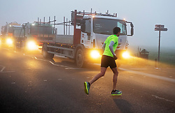 © Licensed to London News Pictures. 27/11/2020. <br /> Blackheath, UK. A runner braving the cold foggy weather on Blackheath Common, London. Freezing foggy weather conditions this Friday morning across large parts of the UK. Photo credit:Grant Falvey/LNP