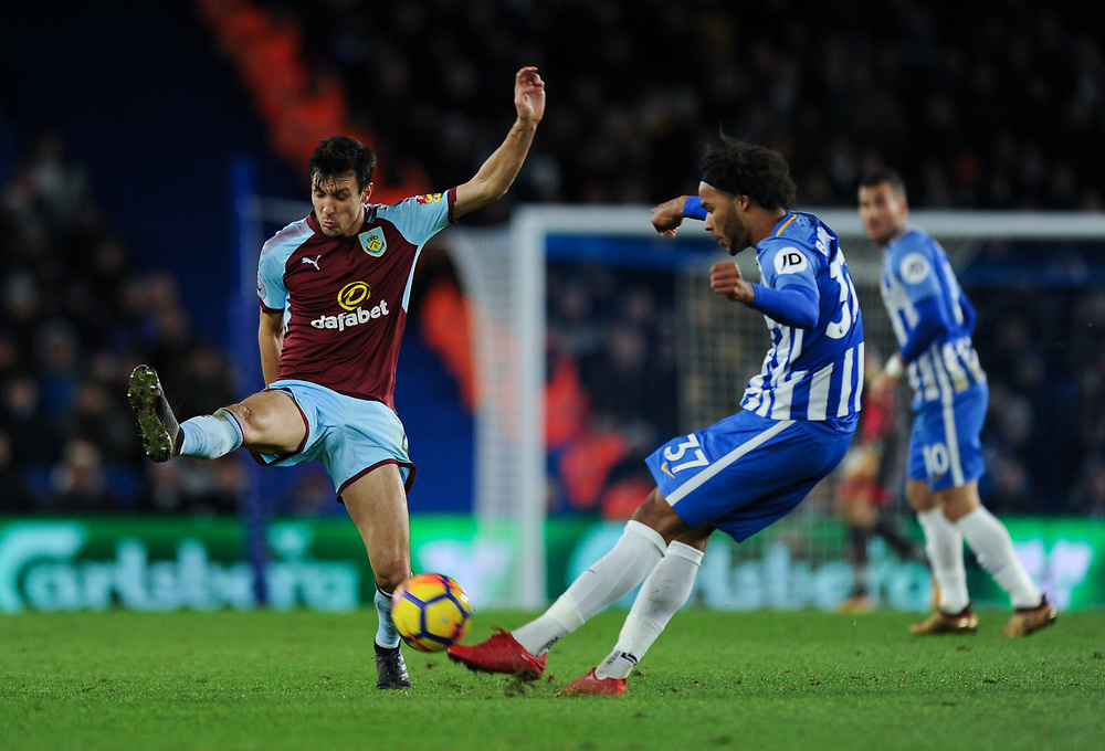 Burnley's Jack Cork closes down Brighton & Hove Albion's Isaiah Brown<br /> <br /> Photographer Ashley Western/CameraSport<br /> <br /> The Premier League - Brighton and Hove Albion v Burnley - Saturday 16th December 2017 - The Amex Stadium - Brighton<br /> <br /> World Copyright © 2017 CameraSport. All rights reserved. 43 Linden Ave. Countesthorpe. Leicester. England. LE8 5PG - Tel: +44 (0) 116 277 4147 - admin@camerasport.com - www.camerasport.com
