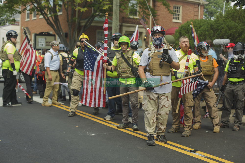 August 12, 2017 - Charlottesville, Virginia, United States - A right wing militia group attempted to do security for the rally on 12 August 2017 in Charlottesville, Virginia, USA.  The Unite the Right instigated brawls between Antifa and various leftists. The brwal ensued and the White Supremacists/Alt Right supporters were forcibly removed by police. (Credit Image: © Shay Horse/NurPhoto via ZUMA Press)