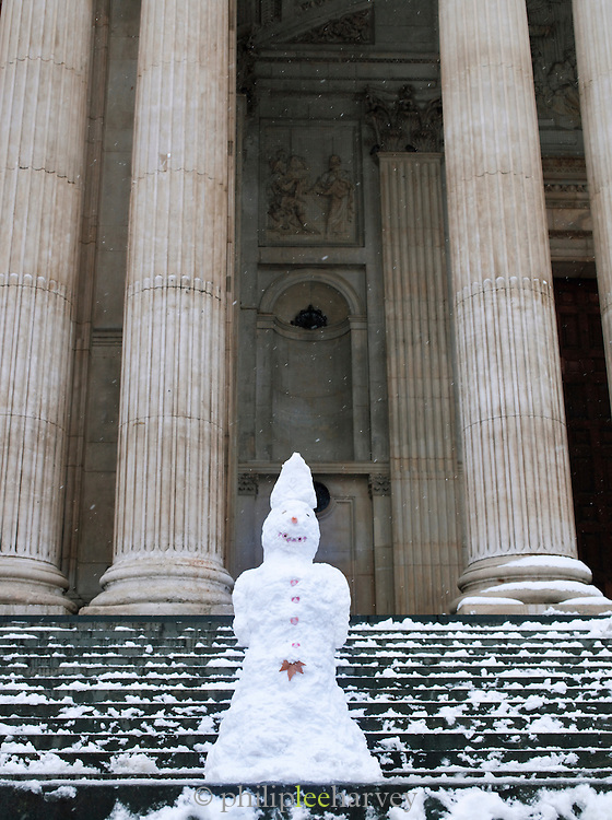 A snowman built on the steps of St Pauls Cathedral in London, UK