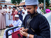 "22 AUGUST 2018 - GEORGE TOWN, PENANG, MALAYSIA: Imams pray before starting the ritual sacrifice of goats during Eid al-Adha services at Kapitan Keling Mosque in George Town. It is the oldest mosque in George Town. Eid al-Adha, ""Feast of the Sacrifice"" is the second of two Islamic holidays celebrated worldwide each year. It honors the willingness of Ibrahim (Abraham) to sacrifice his son as an act of obedience to God's command.     PHOTO BY JACK KURTZ"