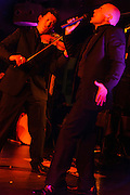 Paul Lazar and Philippe Aymard of Les Oiseaux Noirs Caberet performing in Roppongi, Zero Hour club, Tokyo, Japan, June 27, 2012. The group formed for just four performances in 2012 and mixed song, instrumental performance, pole dancing, tango and yoyo.