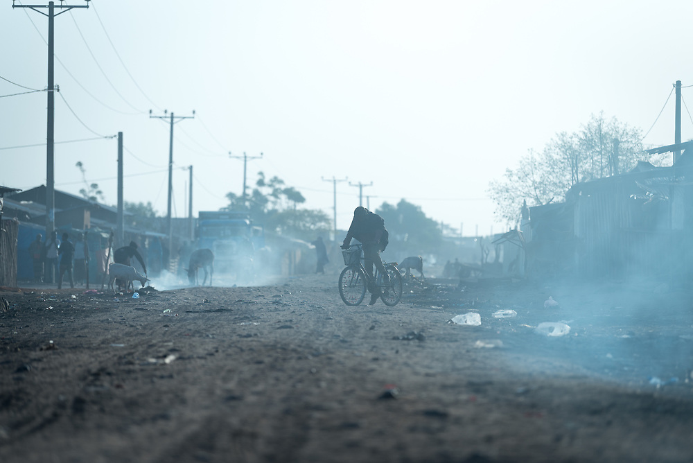 27 January 2019, Micha kebele, Seweyna woreda, Bale Zone, Oromia, Ethiopia: Micha town is suffering drought. Dust and smoke fills the air, as night fires are dying out, lit by people who sleep on the streets.