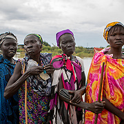 Community members wait in line for a distribution of non-food items, following devestating flooding, in Pibor, Boma State, South Sudan, on 6 November 2019 // Photo credit: UNICEF South Sudan/de la Guardia