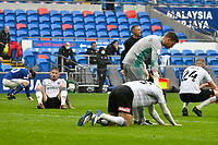 Football - 2020 / 2021 Sky Bet Championship - Cardiff City vs Rotherham United - Cardiff city Stadium<br /> <br /> Rotherham players look dejected after the final whistle, as they await the final results from other grounds,  believing their draw with Cardiff will not be enough to avoid relegation.<br /> <br /> COLORSPORT/WINSTON BYNORTH