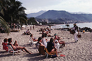 Tourists on the beach at Puerto Vallarta, Mexico.
