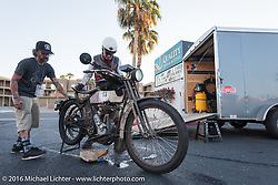 Mechanic Chrystiano Miranda from Brazil helps Dean Bordigioni of California with his Class-1 single-cylinder single-speed 1914 Harley-Davidson in Lake Havasu City during the Motorcycle Cannonball Race of the Century. Stage-14 ride from Lake Havasu CIty, AZ to Palm Desert, CA. USA. Saturday September 24, 2016. Photography ©2016 Michael Lichter.