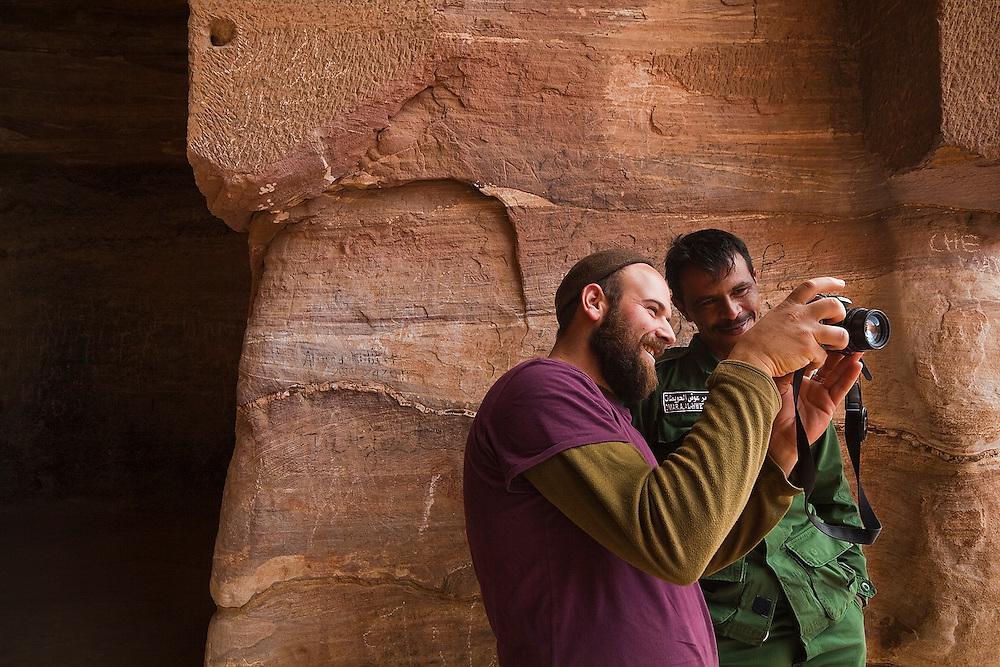Maayan Leshem jokes with a military guard inside the cavernous interior of The Monastery (Al Deir) in Petra, Jordan.