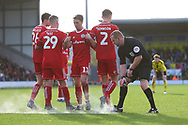 Referee Lee Swabley marks out the position of the Accrington wall during the EFL Sky Bet League 1 match between Burton Albion and Accrington Stanley at the Pirelli Stadium, Burton upon Trent, England on 23 March 2019.