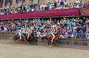 Italy, Siena, the Palio: :from right , Chiocciola, MOntone Onda. the straight section between the Curva del Casato heading to the arrival At the shot of the mortaretto, the horses come out of the Entrone and line up at the starting line, known as the mossa. As soon as the last horse reaches the starting line the race begins and lasts for three rounds of the square (about 1 kilometre in total). The first horse to cross the finishing line is the winner, regardless of whether it is still mounted.