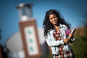 A NSU student portrait in front of the Communications Tower.