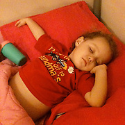 Holly Larue Frizzelle, 2, falls asleep in her bed in January 2013. On December 27, 2012 two year old Holly Larue Frizzelle was diagnosed with Acute Lymphoblastic Leukemia. What began as a stomach ache and visit to her regular pediatrician led to a hospital admission, transport to the University of North Carolina Children's Hospital, and more than two years of treatment.