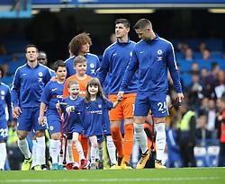 17 September 2017 London : Premier League Football : Chelsea v Arsenal : smiling mascots walk out with the Chelsea team.<br /> Photo: Mark Leech