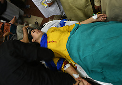 September 7, 2017 - Srinagar, Jammu and Kashmir, India - People carrying a woman injured in grenade blast in Jehangir Chowk Srinagar. Reportedly 16 civilians have been injured in the attack and have been taken to the hospital for the treatment. (Credit Image: © Muzamil Mattoo/Pacific Press via ZUMA Wire)