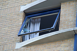©Licensed to London News Pictures 05/07/2020     <br /> Greenwich, UK. A smashed window at the front of the hotel, believed to be from where the male jumped. Detectives are investigating an incident in which a woman was fatally stabbed at the Holiday Inn Express in Greenwich, London. While police attended the scene a male believed to be known to the woman jumped from height, he is in a life threatening condition in hospital.  Photo credit: Grant Falvey/LNP