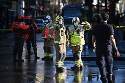 © Licensed to London News Pictures. 21/01/2021. London, UK. The scene in Notting Hill, west London where a burst water main has caused flooding. Police have closed Notting Hill Gate and the Underground station as a precation. Photo credit: Ben Cawthra/LNP