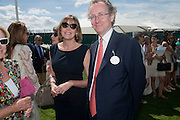 LADY WOOLTON; LORD WOOLTON, Cartier International Polo. Smiths Lawn. Windsor. 24 July 2011. <br /> <br />  , -DO NOT ARCHIVE-© Copyright Photograph by Dafydd Jones. 248 Clapham Rd. London SW9 0PZ. Tel 0207 820 0771. www.dafjones.com.