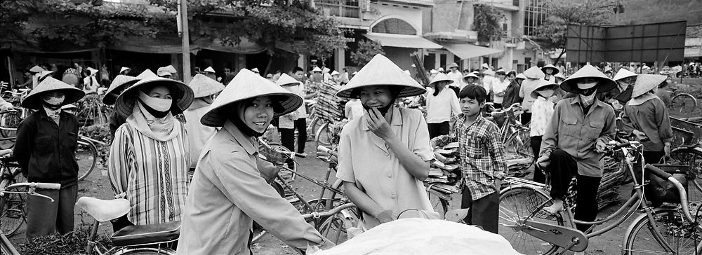 Ladies and bicycles at crowded Bamboo market