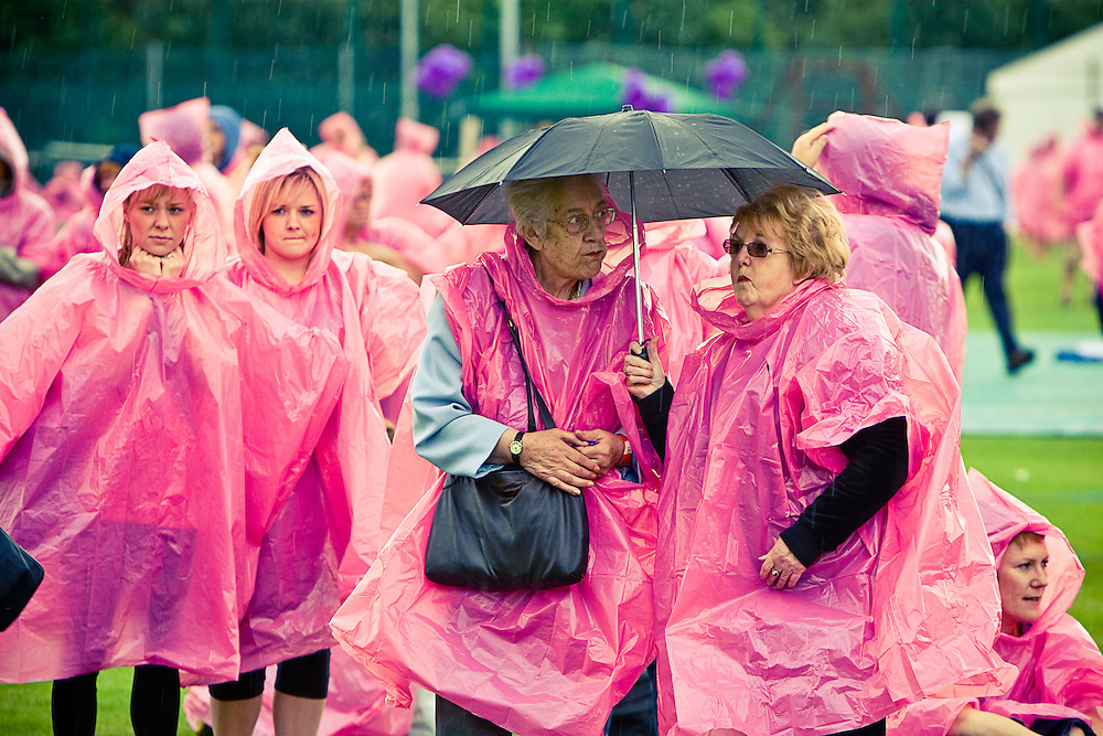 Over 4,000 men and women came out on a stormy Sunday afternoon to show their support in the fight against breast cancer.  The event, held at Liverpool cricket club, got all 4,000 people to stand together in the form of a woman called Lucy.  This image was broadcast around the world to show people supporting the cause.  Despite the heavy rain everyone had fun.