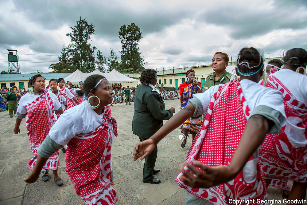 Women from Langata Maximum Security Prison chat amongst themselves during celebrations of Talent Behind Bars, a programme held for International Day of the Gifted by the Government of Kenya and representatives from NGOs at the Nairobi Remand and Allocation Prison in the city's Industrial Area, built in 1911 by the British during the colonial period. Participants and inmates came from the Remand and Allocation Prison, Kamiti Main and Medium Prisons and Langata Women's Prison.