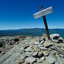 White Mountain N.F., NH.Backpacking. Baldface Circle Trail. North Baldface. Trail signs. Mt. Washington in the distance.