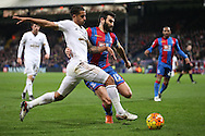 Mile Jedinak, the Captain Palace captain challenges Kyle Naughton of Swansea City. Barclays Premier League match, Crystal Palace v Swansea city at Selhurst Park in London on Monday 28th December 2015.<br /> pic by John Patrick Fletcher, Andrew Orchard sports photography.