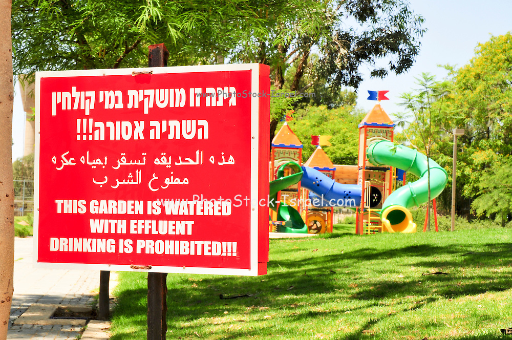 """Israel, Negev Desert, Omer, A warning sign in Hebrew, Arabic and English: """"This garden is watered with effluent, drinking is prohibited"""" in a park, May 31 2009, Due to a shortage of water, Israel is trying to find ways of conserving potable water"""