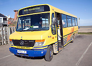 Anglian bus service 165 minibus to Woodbridge parked at Aldeburgh, Suffolk