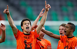 Thom Haye of Netherlands and Jeroen Lumu of Netherlands celebrate after winning the UEFA European Under-17 Championship Final match between Germany and Netherlands on May 16, 2012 in SRC Stozice, Ljubljana, Slovenia. Netherlands defeated Germany after penalty shots and became European Under-17 Champion 2012. (Photo by Vid Ponikvar / Sportida.com)