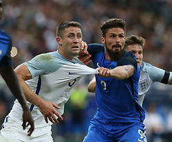 13 June 2017 International Football Friendly Match - France v England :<br /> Gary Cahill of England has his shirt pulled by Olivier Giroud.<br /> Photo: Mark Leech.