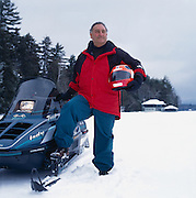 """Sandy Weill, chairman of Citicorp Group at his retreat in Saranac Lake, New York.  """"CUT EXPENSES OR DIE' is written on his helmet."""