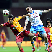 Galatasaray's Juan Emmanuel CULIO (L) and Gokhan ZAN (R) during their Turkish superleague soccer derby match Galatasaray between Trabzonspor at the TT Arena in Istanbul Turkey on Sunday, 10 April 2011. Photo by TURKPIX