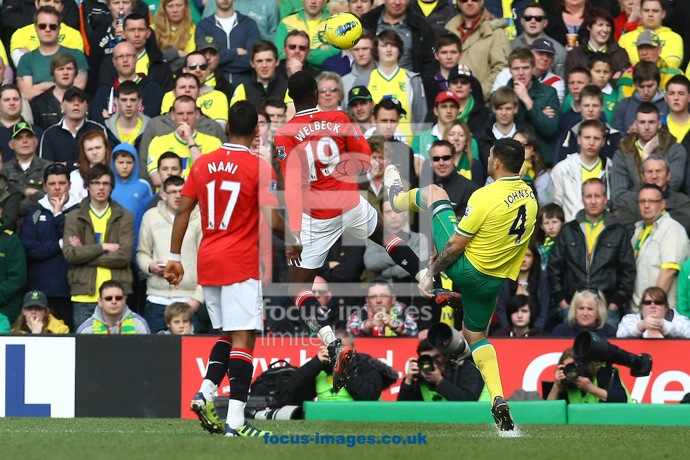 Picture by Paul Chesterton/Focus Images Ltd.  07904 640267.26/02/12.Nani of Man Utd and Danny Welbeck of Man Utd and Bradley Johnson of Norwich in action during the Barclays Premier League match at Carrow Road Stadium, Norwich.