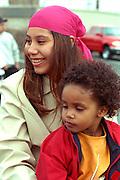 Spectators age 16 and 4 at Cinco de Mayo festival.  St Paul Minnesota USA