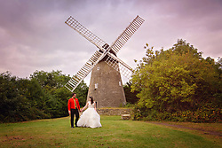 Bride and Groom holding hands in the beautiful grounds at Bradwell Windmill