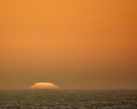Sun Rising over the Atlantic Ocean from the Aft Deck of the MV World Odyssey. Image taken with a Nikon 1 V3 camera and 70-30 mm VR lens