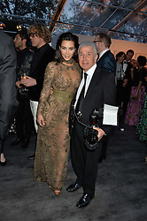 KIM KARDASHIAN WEST and JAMES PELTEKIAN at British Vogue's Centenary Gala Dinner in Kensington Gardens, London on 23rd May 2016.