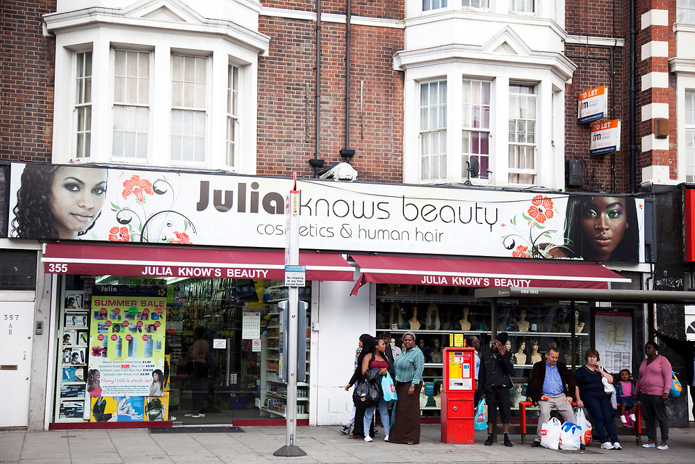 Julia Knows Beauty shop on Camberwell Road in South London. This is a a multicultural area in South London where different people of all nationalities and races mix together.