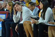 March 18, 2016; Tempe, Ariz;  New Mexico State Aggies head coach Mark Trakh looks up at the scoreboard during a game between No. 2 Arizona State Sun Devils and No. 15 New Mexico State Aggies in the first round of the 2016 NCAA Division I Women's Basketball Championship in Tempe, Ariz. The Sun Devils defeated the Aggies 74-52.