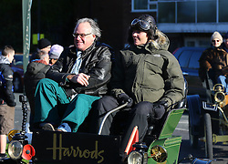 Jodie Kidd and James Healy, Harrods' Director of Store Operations, drive the Harrods 1901 veteran Pope Waverley electric car in the Bonhams London to Brighton Veteran Car Run in Crawley, Sussex.