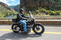 Brent Mayfield on his 1935 Harley-Davidson VJ on Interstate 70 in Glenwood Canyon beside the Colorado River during Stage 10 (278 miles) of the Motorcycle Cannonball Cross-Country Endurance Run, which on this day ran from Golden to Grand Junction, CO., USA. Monday, September 15, 2014.  Photography ©2014 Michael Lichter.