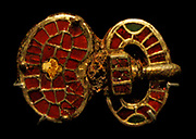 Male burial, 520-540, buckle, copper alloy, silver, garnets and cuttlefish.