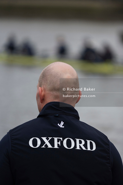 The Australian born Oxford University veteran rower James Ditzell watches another boat go out for a training session on the Thames. Many of his team mates are only 19 but at 45 James is currently the oldest ever rower in the history of the boat race. He trains with the rest of his squad on the Thames from Putney in West London under race conditions, hoping that as race day (April 6th 2012), his times are good enough for a seat in one of two of Oxford boats. First raced in 1829 the boat race between Oxford and Cambridge unbiversities is one of the oldest sporting events in the world. It is nowadays watched by thousands along the banks of The Thames Tideway, between Putney and Mortlake in London and by millions more on TV around the world.