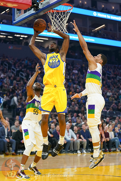 February 23, 2020; San Francisco, California, USA; Golden State Warriors guard Andrew Wiggins (22) shoots the basketball against New Orleans Pelicans guard E'Twaun Moore (55) and guard Josh Hart (3) during the first quarter at Chase Center.